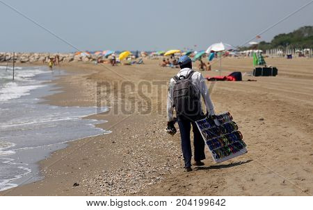 Poor Street Vendor Of Clothes And Dresses Along The Beach