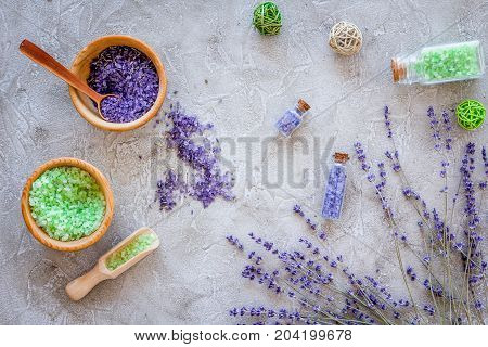 bath salt in herbal cosmetic set with lavender on stone desk background top view