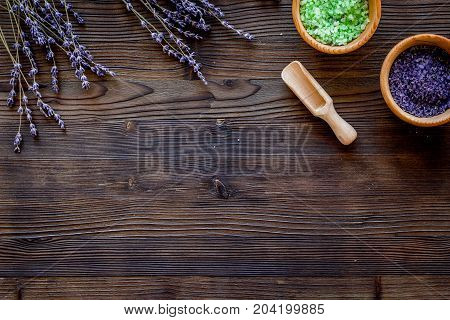 bath salt in herbal cosmetic set with lavender on wooden desk background top view space for text
