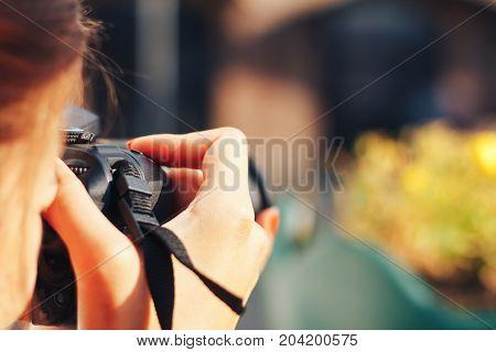MINSK, BELARUS.August 12, 2017 Girl photographer shoots on the street