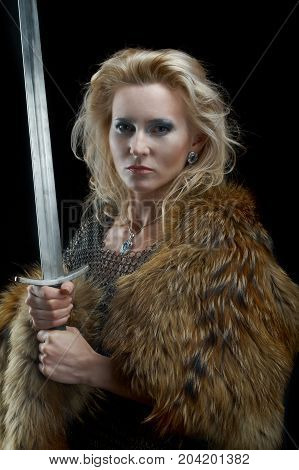 Valkyrie.Viking girl with sword woman, close up