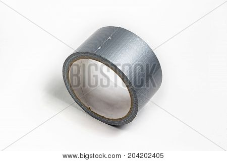 Adhesive tape of silver color. Gaffer tape. Scotch tape on white background.