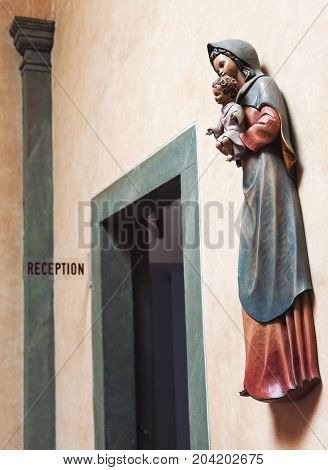Wooden Saint Mary and baby Jesus sculpture as interior detail