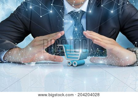 Shopping Cart In The Hands Of The Businessman.