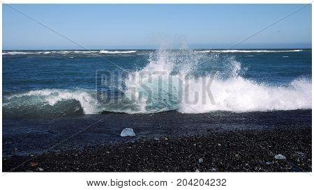 Ice floe in waves, Diamond Beach, Iceland