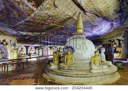 Dambulla, Sri Lanka - August 14, 2017: Interior of the cave of the Great Kings. Dambulla cave temple is a World Heritage Site and is the largest and best-preserved cave temple complex in Sri Lanka