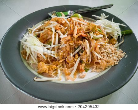 Thin rice noodles fried with tofu vegetable egg and peanuts (Pad Thai)