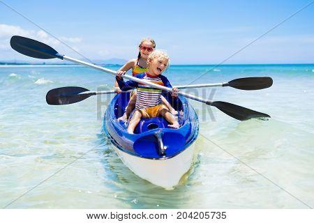 Kids Kayaking In Ocean. Children In Kayak In Tropical Sea