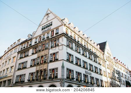 Munich, December 29, 2017: The building of the boutique Hermes. Fashionable Parisian store of various brand clothes and accessories. Marienplatz Square