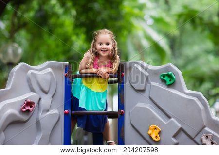 Child On School Playground. Kids Play.