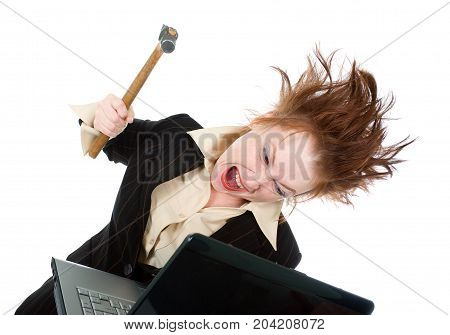 Stressed Businesswoman Smashing Her Laptop With A Hammer