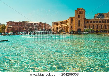 Fountains and beautiful architectural complex on Republic Square. Touristic architecture landmark. Sightseeing in Yerevan. City tour. Government House. Travel and tourism concept. Sunny autumn day.