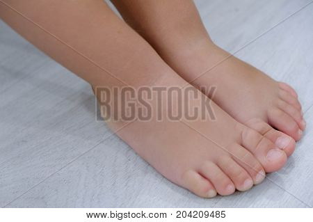 Children's bare feet. Child's bare feet the wooden floor