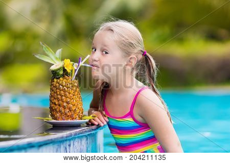 Child With Pineapple Juice In Pool Bar