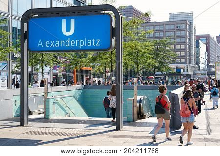 BERLIN, GERMANY - AUGUST 08, 2017: Tourists and residents in the area of the subway station Alexanderplatz in Berlin. The subway is a popular means of transport to explore the city.