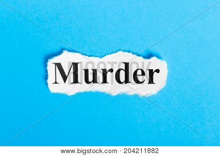 Murder text on paper. Word Murder on a piece of paper. Concept Image.