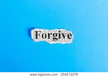 Forgive text on paper. Word Forgive on a piece of paper. Concept Image.