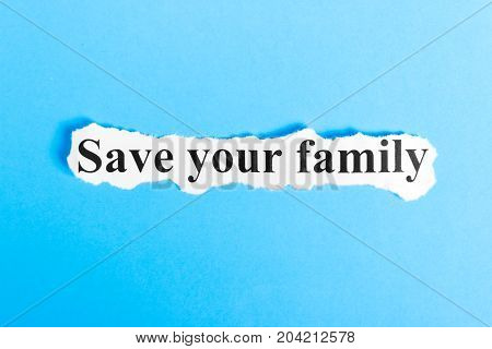 Save your family text on paper. Word Save your family on a piece of paper. Concept Image.
