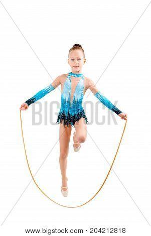 young girl doing gymnastics position over white