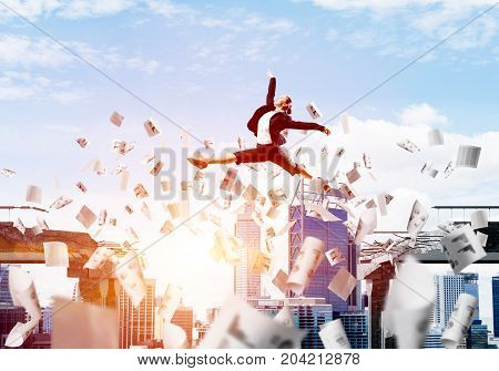 Business woman jumping over gap with flying paper documents in concrete bridge as symbol of overcoming challenges. Cloudly skyscape with sunlight on background. 3D rendering.