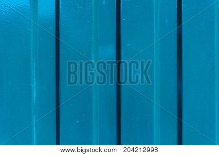 blue metal wall with horizontal lines close up