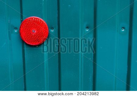 tourquoise blue metal aluminium wall with red light horizontal lines