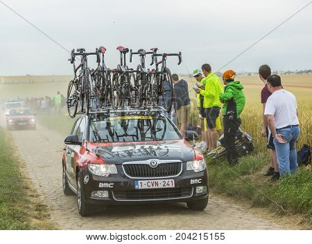 QuievyFrance - July 07 2015: Image of the technical car of BMC Team driving on a cobblestoned road during the stage 4 of Le Tour de France 2015 in Quievy France on 07 July2015.