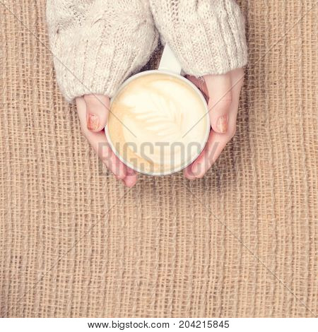 Girl Holding Cup Of Coffee With Latte Art. Leasure Time Concept. Pastel Colors