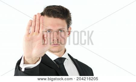 Stop Gesture By Businessman Isolated On White Background