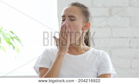 Yawning Tired Young Woman, Need Sleep, Portrait In Designer Office