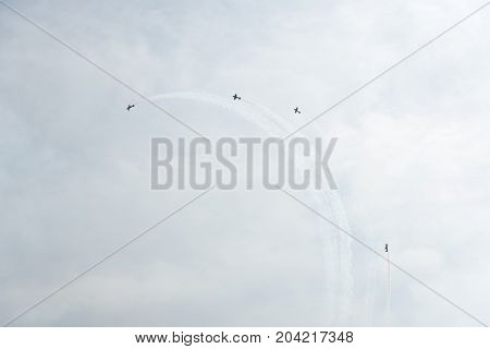 Airplanes In The Sky On A Cloudy Day
