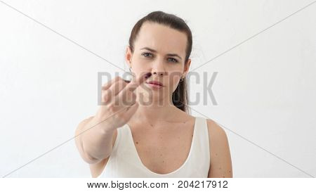 Angry Woman Showing Middle Finger In Frustration In Designer Office