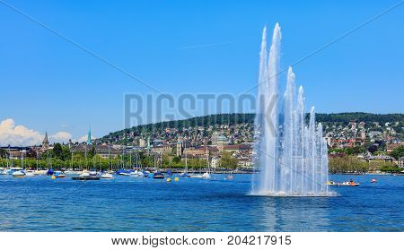 Zurich, Switzerland - 26 May, 2016: Lake Zurich, the city of Zurich in the background. Lake Zurich is a lake in Switzerland, extending southeast of the city of Zurich.
