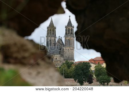 MAGDEBURG, GERMANY - September 13, 2017: View of the cathedral of Magdeburg through a hole in the masonry. (Magdeburg is the sister city of Nashville, USA)