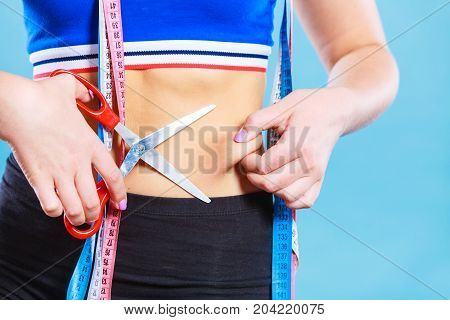 Woman Pinching Waist For Skin Fold Test