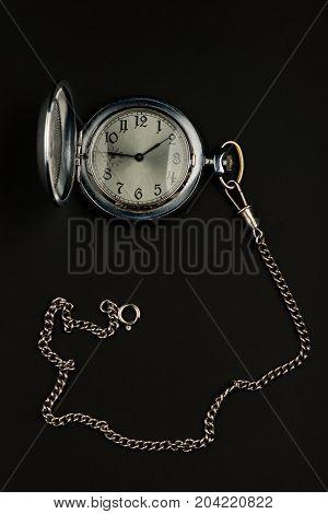 pocket watch on black background, old watch, mechanical watch