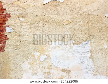 Old Weathered White Cracked Wall With Red Brick Fragment. Grunge Urban Background