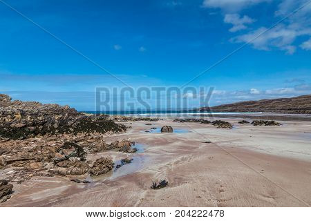 Achnahaird Bay Beach, sand  and rocks on a beautiful day.