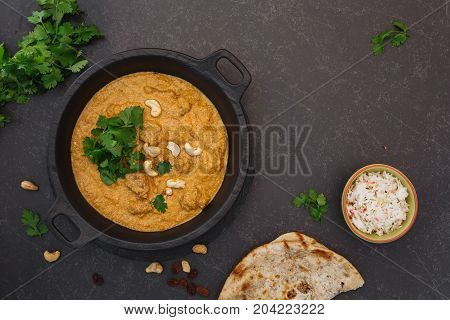 Traditional Indian lamb curry  with rice and peshwari naan.  Top view, blank space