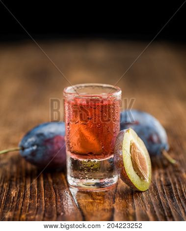 Wooden Table With Plum Liqueur, Selective Focus