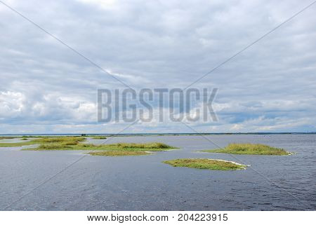 Coastal wetland with small green islands by the coast of the swedish island Oland in the Baltic Sea