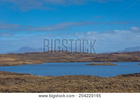 Loch an t-Slagain with An Teallach in the distance.
