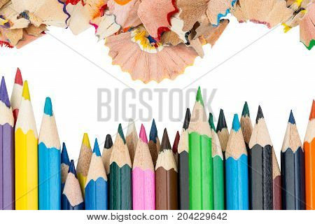Shavings and color pencils in front of