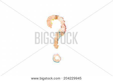 The question mark from pencil shavings on white background