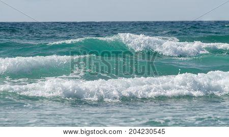 Beautiful tidal waves against the sky. Seascape.