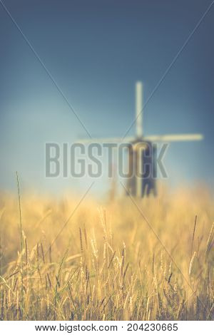 Retro Vintage Style Wheat Field With A Windmill In The Background With Shallow DoF