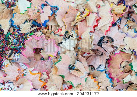 Large and small shavings from pencils on grey background