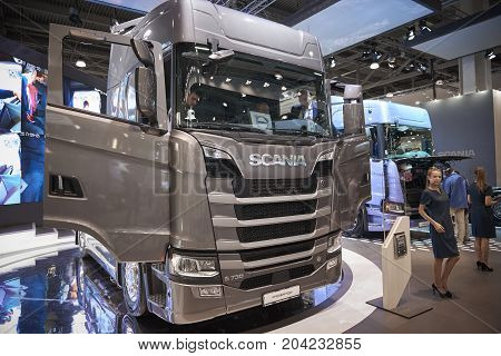 MOSCOW, SEP, 5, 2017: View on gray truck Scania exhibit on Commercial Transport Exhibition ComTrans-2017. Scania trucks. Automobile industry. Popular and newest Commercial trucks cars exhibition booth