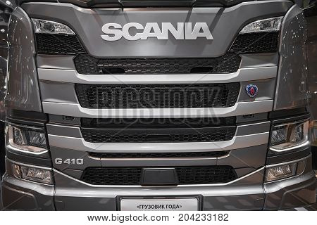 MOSCOW, SEP, 5, 2017: View on gray truck hood radiator grill of Scania truck exhibit on Commercial Transport Exhibition ComTrans-2017. Trucks engine hood. Automobile industry