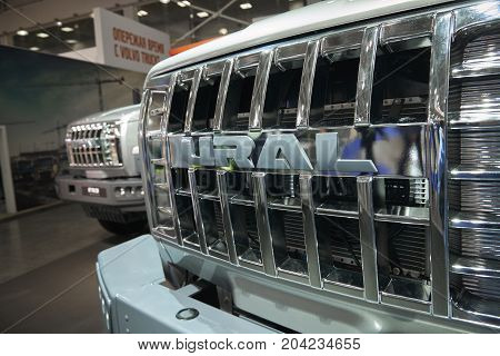 MOSCOW, SEP, 5, 2017: Close up view on URAL truck and logo on car radiator. Off road cargo trucks for civil military transportation. Stand on Commercial Transport Exhibition ComTrans-2017